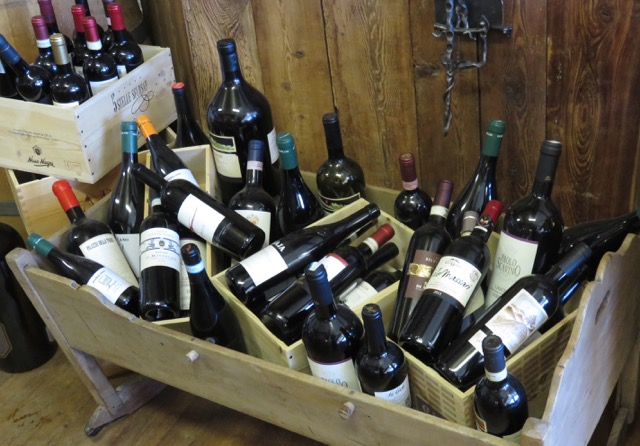 Local wines welcome visitors to a mountain hut in the Monte Rosa