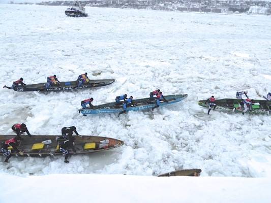 Racers race across the icy St Lawrence River at Quebec City